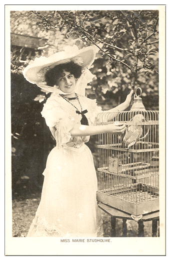 Miss Marie Studholme with her parrot